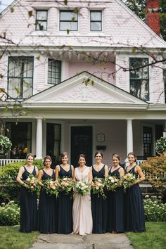 Garden wedding bridesmaids in navy - lovely bouquets too!