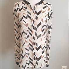 DKNY Top DKNYC Top by DKNY. Sheer polyester top with leatherette trim at neck and cuffs.  Brown, cream and black graphic design.  Good condition.  There are a few runs throughout as shown but they are faint and unnoticeable.  Fits true to size. DKNY Tops