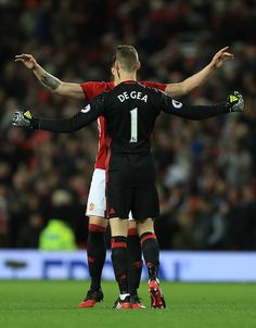 David De Gea and Phil Jones of Manchester United celebrate their 10 win after the Premier League match between Manchester United and Tottenham...