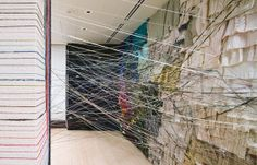 Unraveling, by Jean Shin, 2006-09  Yarn of sweaters collected from the Asian American art community.  Dimensions variable.