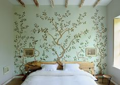 Pretty mural and that awesome(!) driftwood headboard