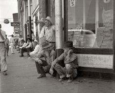 """August 1936. Sallisaw, Oklahoma. Sequoyah County drought farmers. """"Nothing to do,"""" said one of them. """"These fellers are goin' to stay right here till they dry up and die."""" Medium-format nitrate negative by Dorothea Lange"""