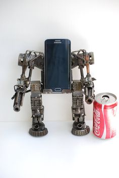 See all shop sessions and all models in our shop link below https://www.etsy.com/shop/Metalmodelhouse?ref=hdr_shop_menu Robot Phone holder metal model is made from scrap/recycled metal and auto parts. This model is 100% hand-made by expertised Thai craftsman. This sculpture is very