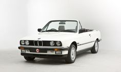 My first car after college: 1990 BMW 325i convertible. White with tan interior.