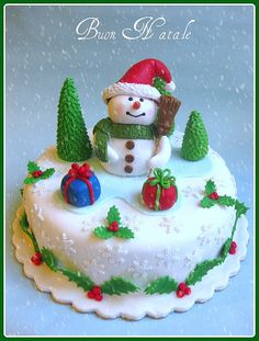 Christmas cake with snowman trees holly gifts snowflakes