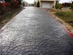 concrete stamped driveway - instead of actual cobblestone (saves time and a lot of money)