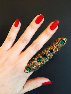 A personal favorite from my Etsy shop https://www.etsy.com/listing/268862420/shield-full-finger-ring-made-with-a