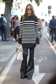 Carlotta Oddi plays with proportions in an Isabel Marant sweater dress and leather flares.    - HarpersBAZAAR.com