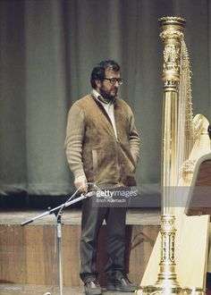 Italian composer Luciano Berio (1925 - 2003) with a harp, circa 1965.