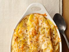 Simple Scalloped Potatoes : This basic version of scalloped potatoes has a chicken broth- and milk-based sauce and a Gruyere topping. Use a mandoline for quick, even potato slices.