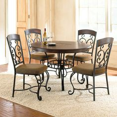 Bring the romantic look of wrought iron to the table with the Greco Dining Collection, featuring eye-catching curves and stylish details. The Greco 45� round dining table features a dark wood top accented with a slate tile mosaic center.  With the addition of the Greco side chairs, you can...