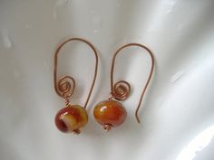 Handmade pure Copper hand forged spiral earrings with green and brown agate rondelles.  £10.95. by CalicoRoseStudio on Etsy.