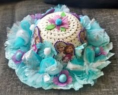 Hand Made Frozen styled Girls Easter Bonnet Hat A lovely Easter bonnet in a blue white and lilac colour scheme , with Anna and Elsa and little Easter eggs . I am happy to combine postage, and please feel free to email me any questions. Thanks for looking and why not take a look at my other items listed. | eBay!