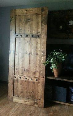 Traditional Gate Design Handle with Industrial Iron Strap and Large Troubled Toenail Heads Great for moving barn doors barn door equipment and also other indoor doors - May 18 2019 at Rustic Pantry, Door Design, Wood Doors, Rustic Hardware, Barn Wood, Barndoor Headboard, Wood Doors Interior, Rustic Doors, Indoor Doors