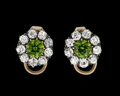 """Edwardian Demantoid Garnet Earrings, 2.50 Carats~ These exquisite Edwardian earrings feature two brilliant green demantoid garnets totaling approximately 2.50 carats. The word """"demantoid"""" means """"diamond-like,"""" and for this stone, the description is most fitting. These stones exhibit an incomparable brilliance and fire, and they have been a favorite of collectors since their discovery in 1868. Set in 12K gold and silver with diamond accents. ~M.S. Rau Jewelry Box, Vintage Jewelry, Garnet Earrings, Rare Gemstones, Alexandrite, Exhibit, Peridot, Discovery, Fire"""