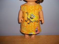 Baby 12 inch Alive doll handmade dress is yellow with Sponge Bob on it by sue18inchdollclothes on Etsy