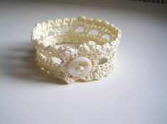 Hey, I found this really awesome Etsy listing at http://www.etsy.com/listing/48619561/shell-button-lace-wristlet-mother-of