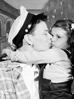 1943 - Frank Sinatra Giving A Kiss To Daughter Nancy