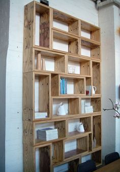 Interesting mix of horizontal and vertical shelves. This set of shelves has a very geometric, and therefore contemporary, vibe. -- I'm cheating on fashion with furniture.Miss Kitty-Cat Goes to Town(Mix Wood Shelves) Dvd Storage, Storage Ideas, Wall Storage, Storage Boxes, Creation Deco, Ideias Diy, Deco Design, Pallet Furniture, Home Organization