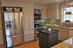 kitchen cabinets around refriagerator | Wall oven removed, refrigerator built in, cabinets built up and ...