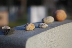 I've always wondered why I see small stones on top of headstones...now I know what it means!
