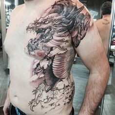 Chronic Ink Tattoo - Toronto Tattoo Front side dragon tattoo in progress by Tristen.