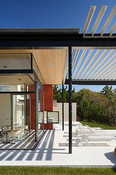 The pair of ocean front houses, on adjacent lots in Montauk, NY, were designed to capture that rarest of assets: large private outdoor space on the Atlantic. The main house is earthbound: a low-slung single story composed of an open (steel and glass) wing and an embracing (brick and wood) one...