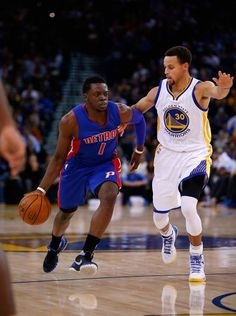 Reggie Jackson of the Detroit Pistons is guarded by