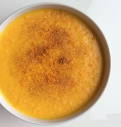 Carrot soup with orange and ginger, cinnamon topping