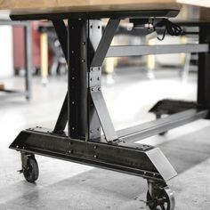 detail shot of it beams and aged brass hardware on conference table Real Industrial Edge Furniture designed and built.