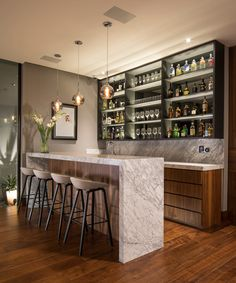 This modern house has a bar that features a shallow shelf with a mirrored back and hidden lighting to highlight the bottles and glassware. bar, GLR Arquitectos Have Designed The ER House To Take Advantage Of The Mountain Views Home Bar Rooms, Diy Home Bar, Home Bar Decor, Home Decor Kitchen, Mini Bar At Home, Diy Kitchen, In Home Bar Ideas, Kitchen Recipes, Mini Bars