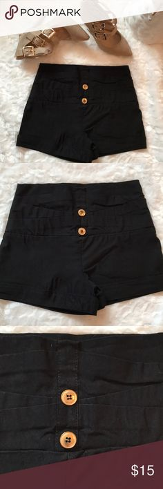 WET SEAL High-waisted black shorts ☃️🌹 WET SEAL high- wasted and very stretchy black shorts with gold buttons💋 size medium worn a few times Wet Seal Shorts