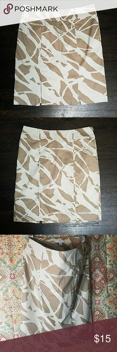 Brown and Beige Patterned Skirt This A-line skirt is super cute! With a double slit in the back, you'll be pleased having this piece!! New York & Company Skirts A-Line or Full