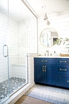 farmhouse bathroom design with cement tile floor and white subway tile shower, blue bathroom cabinets, blue bathroom vanity with shiplap and round mirror in neutral bathroom design, cottage bathroom decor blue You searched for tile Neutral Bathrooms Designs, Bathroom Trends, Bathroom Renovations, Nautical Bathrooms, Bathroom Designs, Remodel Bathroom, Decorating Bathrooms, Restroom Remodel, Bathroom Hacks