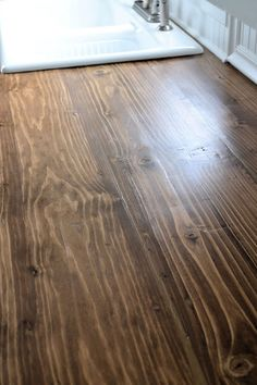 We made our own countertop with 2 - 2 x 10 boards and 1 - 2 x 8 board. The cracks were filled with wood filler, stained and sealed with polycrylic. We got the inspiration for the countertop from this post HERE.