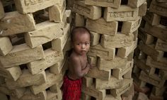A child stands next to drying bricks at a factory on the outskirts of Rangoon. Demand for property in Rangoon has surged as Burma undergoes rapid change. Sales prices have doubled or even trebled over the past two years in some neighbourhoods as developers scramble to build new properties.