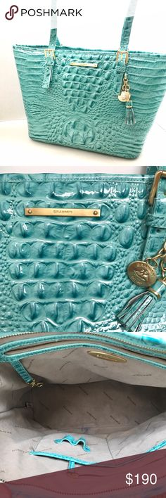 Authentic Brahmin handbag Turquoise zip-top tote by Brahmin. Polished, classic design featuring adjustable handles, an exterior back pocket, and footed bottom. Finely crafted from Brahmin's signature embossed leather. Interior zip pocket with two organizer pockets. Only worn a few times and in excellent condition. There is a small ink spot on the interior lining and a light scuff (from brushing against polished nails) on the bottom corner. Brahmin Bags Satchels
