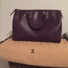 Louis Vuitton Epi Speedy 25 Cassis Purple I'm not sure if I want to sell this bag or spend the money and get it cleaned. Good condition outside, shows minor signs of use and couple of scratches in the bottom. Inside bunch of ink and make up stains. This color is hard to find and sold out everywhere. Comes with dustbag , lock and key! Louis Vuitton Bags