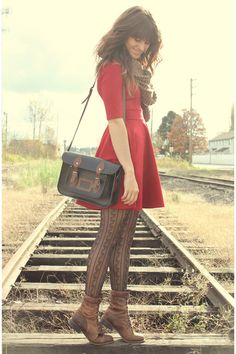 Like the color combination and boots with red dress