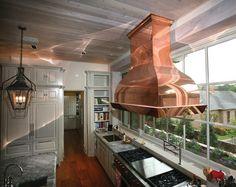 Handcrafted Custom Copper Vent Hood overlooking Custom Copper Planter Box #luxurykitchen #gorgeouskitchen #customcopper #indoordesign #interiordesign #luxuryhomes #custom vent hoods #dreamkitchen #beachsheetmetal