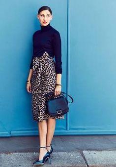 black turtleneck, print skirt, heels