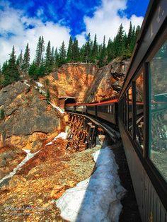 The White Pass Railroad navigates the snowy mountains of Skagway, Alaska.