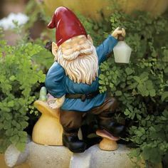 Donning the traditional red cone hat, our friendly gnome inspires smiles in the garden. His handy LED solar lantern will provide 6-8 hours of light at night when battery is fully charged. Caterpillar on mushroom glows too! Hand-painted, weather-resistant resin. On/Off switch. 10 1/4h, 7 1/2w. by PartyLite® Candles