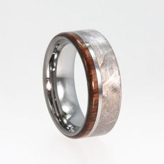 This Tungsten ring is crafted with Ironwood and Meteorite. Ring Width: 8mm Ring Layout:2mm Ironwood, 1mm Tungsten, 5mm Meteorite Tungsten rings can only be made in a width of 8mm. You can replace the wood with any wood available in my store (mix and match). Ring Armor – If wood [...]