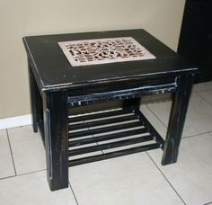 A solid oak table was strong enough.  Insert antique cast iron floor grate.  Oooooo.