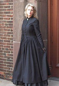 Buttoned front plain dress with petticoat.