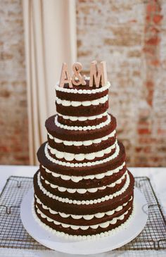 We love this 'naked' cake for a chic Brooklyn wedding.