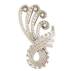 Swirl brooch platinum diamonds   From a unique collection of vintage brooches at https://www.1stdibs.com/jewelry/brooches/brooches/