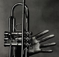 Miles Davis hand and trumpet, 1986. Photo by Irving Penn.
