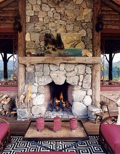 Fabulous stone fireplace on the porch of my favorite mountain house belonging to Celerie kimball's Mother, Mimi.  Talk about a chic porch...she is a designer, and a good one. I want to move!